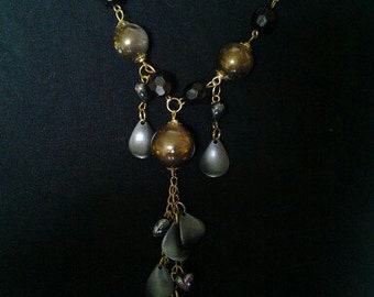 Goldtone chain necklace with bauble clusters and hearts