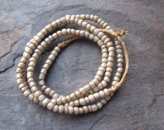 Dirty White Pearlescent Glass Goomba Beads from Ghana 3x4mm (1 strand)