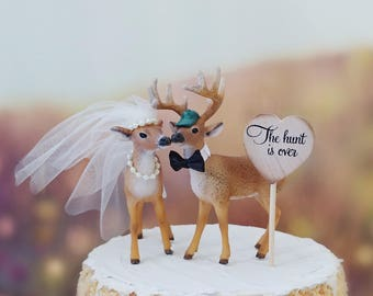 Buck doe bride and groom wedding cake topper hunting themed camouflage the hunt is over antler rack decorated deer rustic country wedding