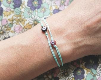 evil eye string bracelet / friendship bracelet / aqua string bracelet/ lucky charm bracelet/ pastel bracelet