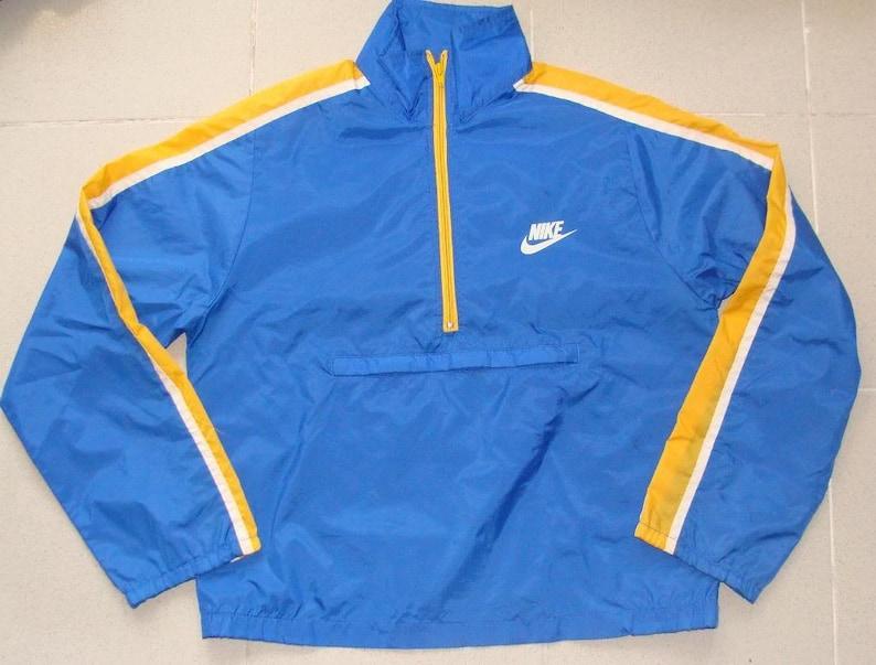 24b53a84ae15 Vintage 80s NIKE SWOOSH Blue Tag WINDBREAKER Jacket