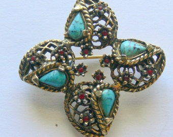 gold plated and ruby - turquoise stone brooch