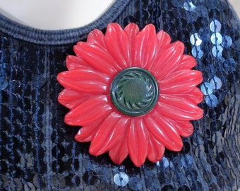 Huge Carved Red Bakelite Flower with Raised Dark Green Center