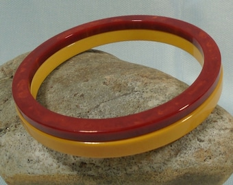 Pair Slim Bakelite Bracelets Simichrome Tested One Solid Sunny Yellow and One Paprika & Yellow Marble Glossy Pair of Catalin Bangles