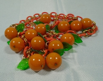 Fruit Themed Bakelite Bead Necklace on Celluloid Chain Simichrome Tested Bright Orange and Yellow Marbled Beads with Green Plastic Leaves