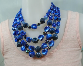 Four Strand Blue Plastic Graduated Bead Necklace Includes Variety of Bead Shapes and Shades of Blue Made in Japan