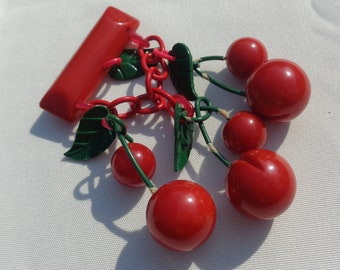Bakelite Pin Carved Red Cherries Bakelite Brooch Classic Bakelite Pin with Carved Red Cherries Dangling On Celluloid Chain with Green Leaves