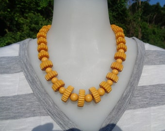 "Bakelite Necklace Carved Gear and Bead Graduated Necklace Simichrome Tested 20"" Long Yellow Bakelite Graduated Gear and Bead Necklace"