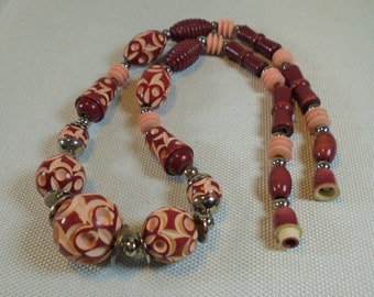 Vintage Celluloid Carved and Dyed Art Deco Necklace Burgundy Red Beads with Pale Pink Carved Areas and Pale Pink Beads