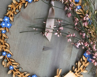 PRE ORDER ONLY : A Beautiful Hand Painted Birchwood Floral Wreath in Forget - me - Not Blue with a Detachable Hare