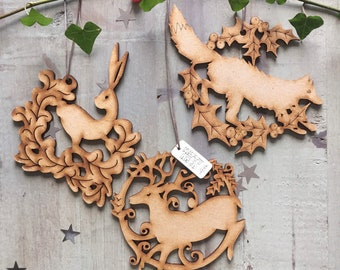 Three Laser Cut Yuletide Decorations with a Woodland Theme