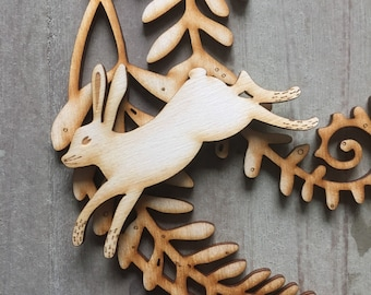 A Beautiful Wooden Fern Rondel  with a Removable Leaping Hare  Free U.K. Delivery