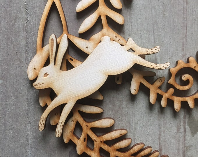 Featured listing image: A Beautiful Wooden Fern Rondel  with a Removable Leaping Hare  Free U.K. Delivery