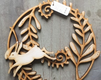 A Beautiful Wooden Fern Rondel  with a Removable Leaping Hare