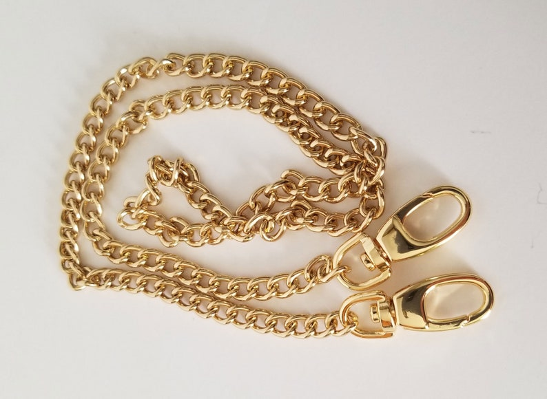 Single link chain strap in bright gold finish high quality image 0