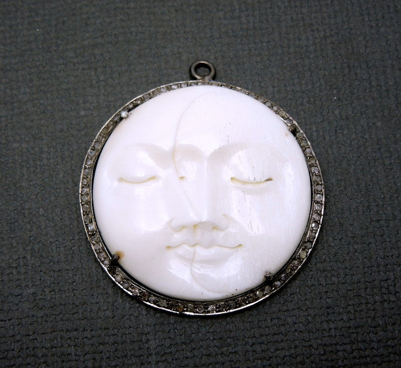 EX20-07D Round Moon Face Pendant in an Oxidized Sterling Silver and Pave Diamond Bezel Pave Diamond and Round Carved Bone Pendant