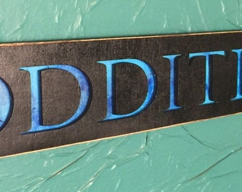 cut our Blue ODDITIES sign - laser cut wood sign