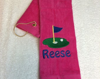 Personalized golf towel with custom embroidery included in the price