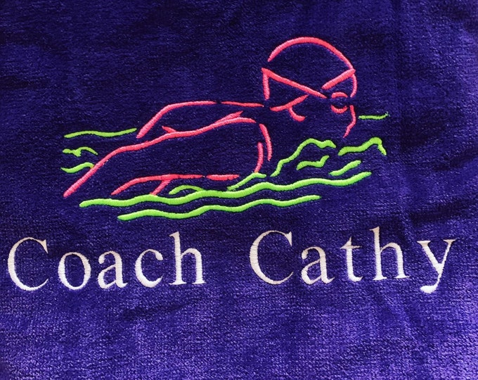 Swim team towels with personalized embroidery included.