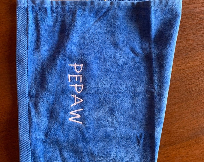 Monogrammed towel with custom personalized embroidery included.