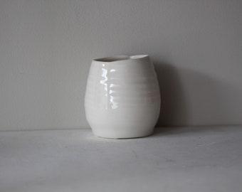 Small translucent porcelain candle holder