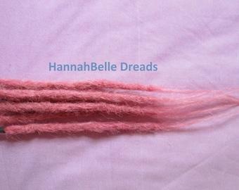 Human hair dreadlock extenders extensionsmedium pink on the weft RTS sample
