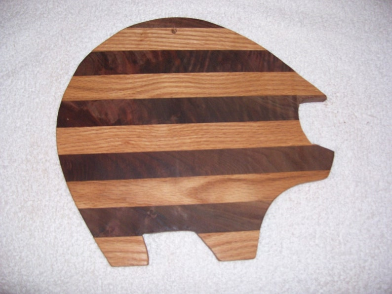 made from  oak and walnut Pig cutting board
