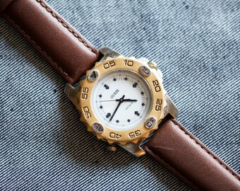 Vintage Mens size guess watch with rotating bezel and brown leather strap