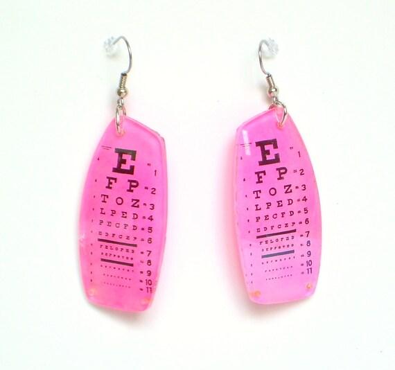 Neon pink eye chart earrings made with prescription Rx eyeglass lenses