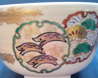 Japanese Kyo-yaki hand painted vintage tea bowl. cream glaze camellia with celadon accents