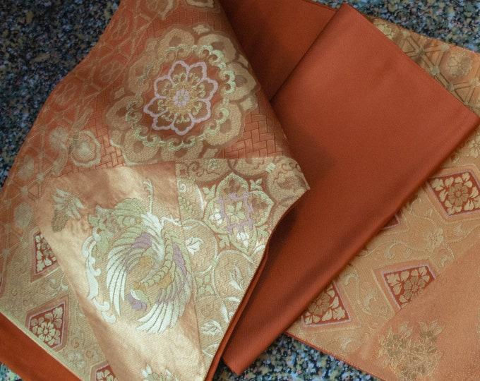 Vintage Japanese fukuro silk  woven crane bird and flowers gold thread with burnt orange reverse.