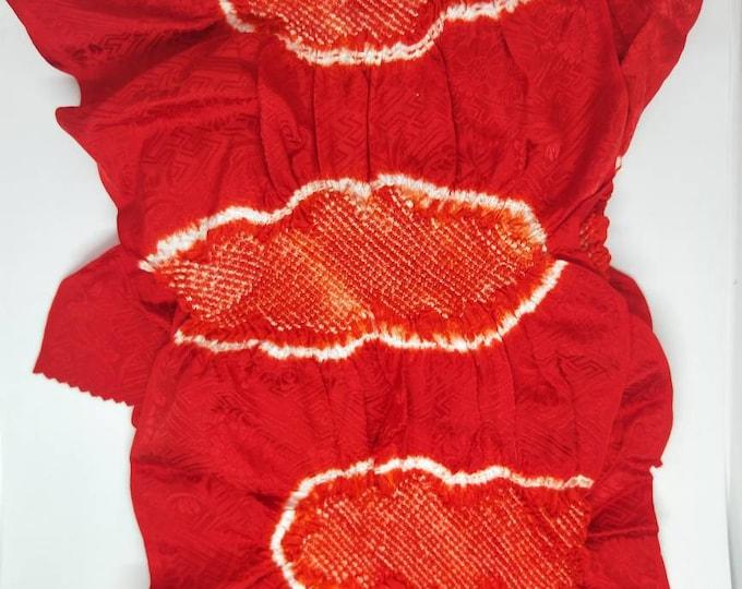Vintage Japanese rinzu silk kimono obi-age red coloured silk with clouds partial shibori 146 cm long. Not Mint.