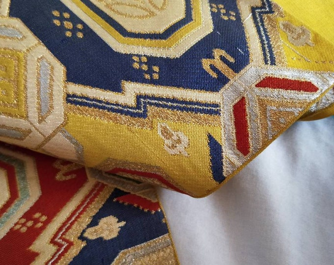 Vintage Japanese fukuro silk woven geometric pattern, yellow reverse, metallic threads. Burnt orange, blue green, gold colours. Not Mint