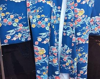 Vintage Japanese medium  weight chirimen crepe fabric w/ floral bingata pattern kimono. Rich royal blue. Very good condition.