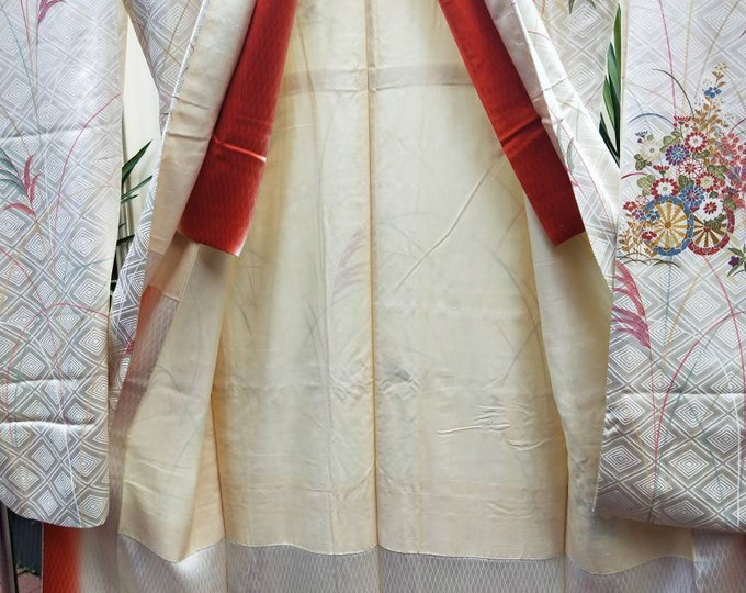 Vintage Japanese cream rinzu silk Furisode kimono w/ flowers and grass. Woven diamond pattern. Elegant and understated.