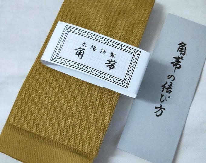 Mens kaku obi with textured woven pattern dark ochre yellow