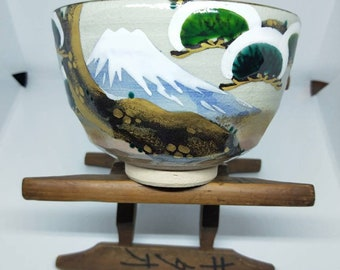 Vintage Japanese hand-made tea bowl. Hagi-ware glaze,  with cream stoneware body, cream glaze and on-glaze painting of Mnt Fuji, pine trees