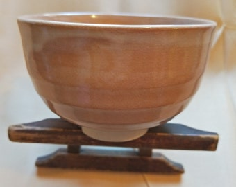 Vintage Japanese hand-made glazed tea bowl. pink terracotta drip glazed on  with cream stoneware body.