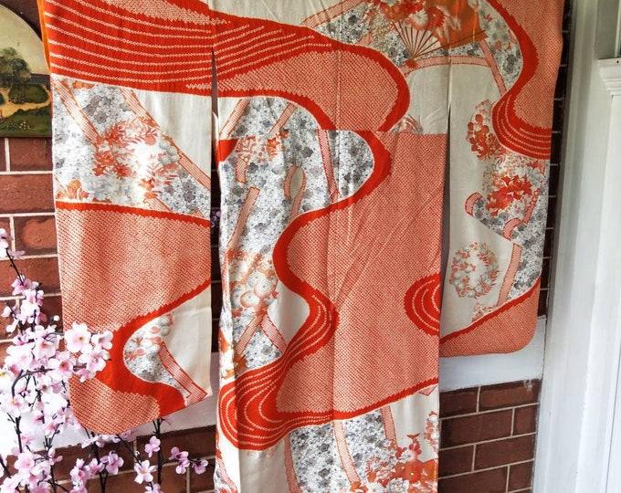 Vintage Japanese orange shibori rinzu silk Furisode kimono w/ swinging sleeves.