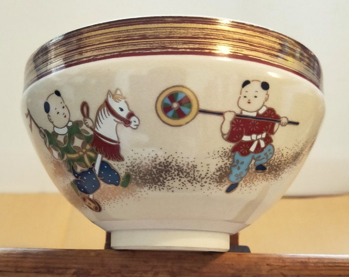 Japanese Kyo-yaki hand painted vintage tea bowl.  Chinese children, Black and cream ceramic teabowl. Signed.