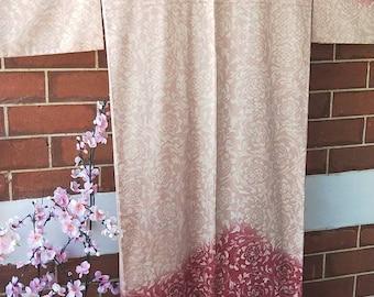 Vintage Japanese pink rinzu houmongi silk kimono with woven interlocking pattern and floral foliage spirals.