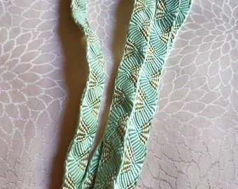 Vintage Japanese silk kumihimo obijime cord for obi celadon green with fan shaped accents flat type.