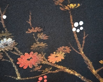 Vintage Japanese hand stitched silk haori  kimono jacket black with subtle woven plum blossom with white lining. Single embroidered crest