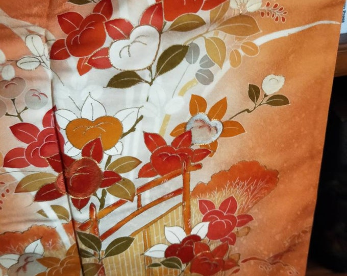 Vintage Japanese silk hand stitched kimono with hand painted persimmon flowers.  Vibrant orange.