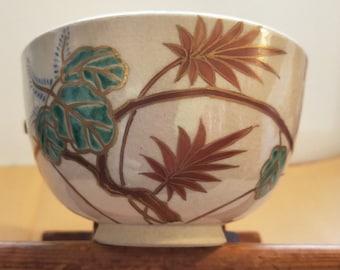 Japanese Kyo-yaki hand painted vintage tea bowl. Pauwlina flowers ceramic teabowl. Signed.