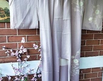 Vintage hand stitched Japanese lavender rinzu houmongi silk kimono with woven diamond grid pattern and shibori flowers. Elegant and refined.