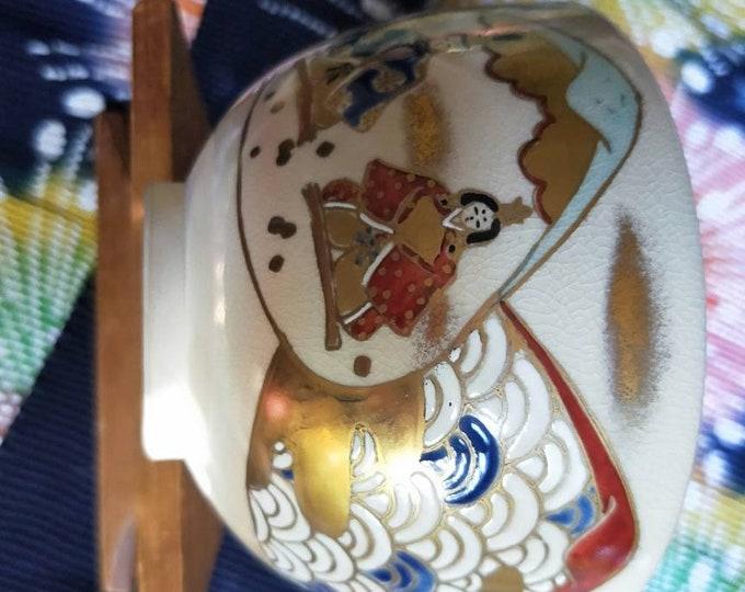 Vintage Japanese hand-made Kyoware glazed tea bowl, chawan . Painted on-glaze enamel emperor and empress clear glaze,  white porcelain body.