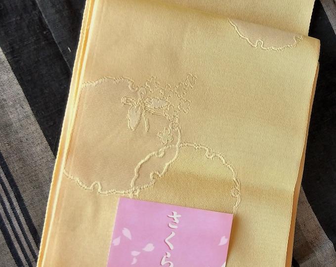 Hanhaba (half-width obi) with snowflake pattern in lemon yellow for kimono.