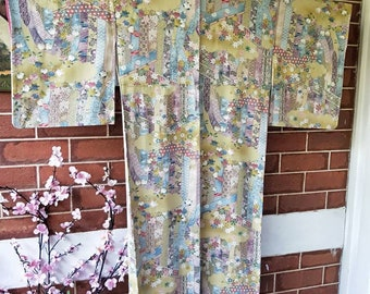 Vintage hand stitched Japanese  pistachio green silk with floral screen and flowers . Komon kimono, gorgeous colour comb with gold accents