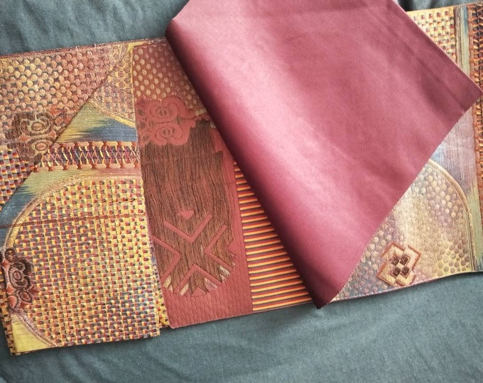 Beautiful vintage Japanese silk obi abstract pattern, wine red ground.